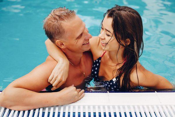 elegant-couple-swim-in-the-pool-XNWHKDR.jpg